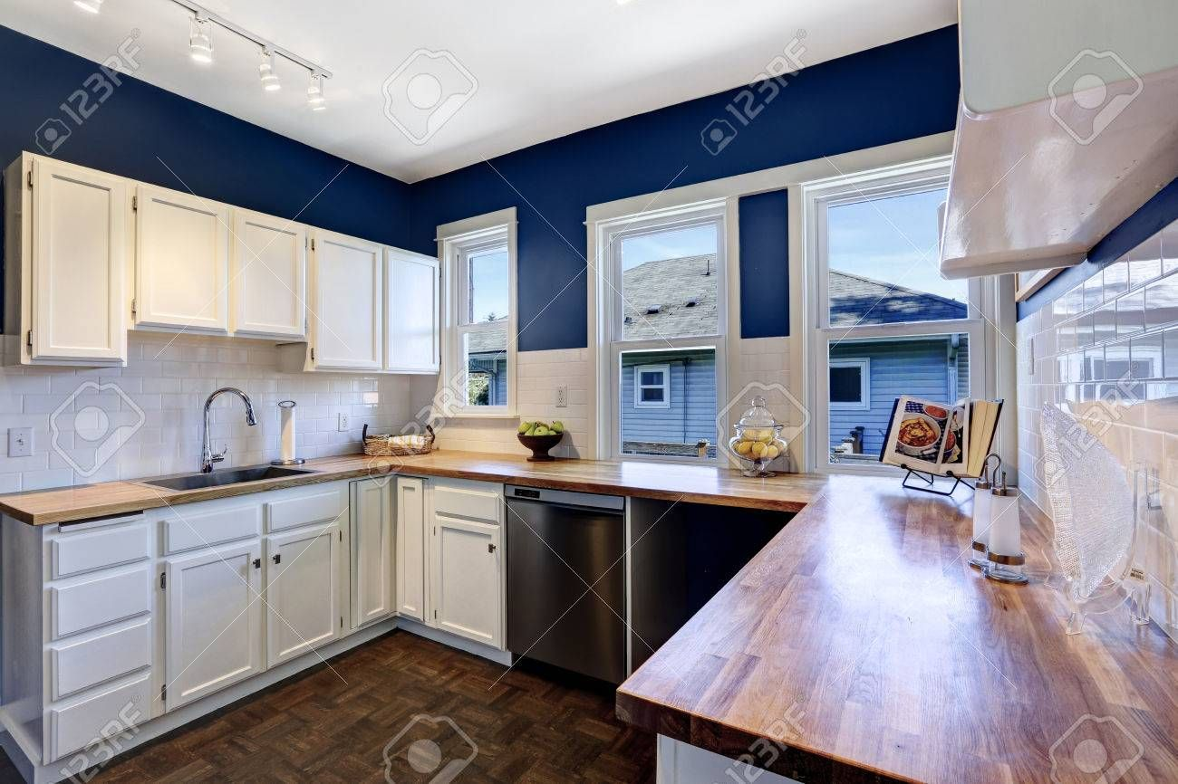 Image result for navy blue kitchen with white cabinets ...