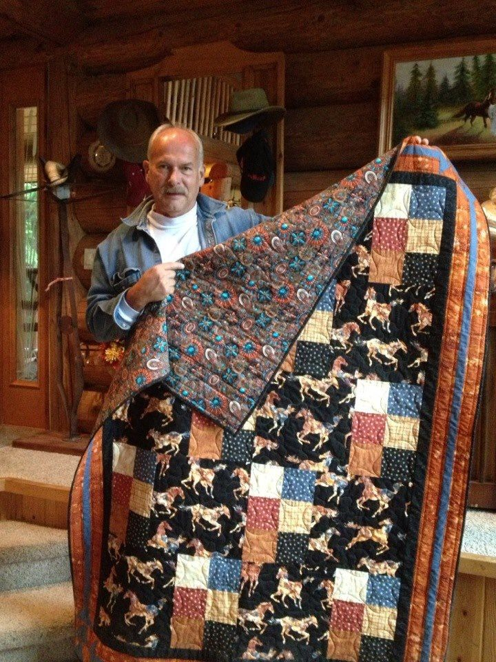 """Sam with his """"horsing around"""" quilt."""