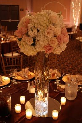 brown tablecloth, white flowers, gold setting