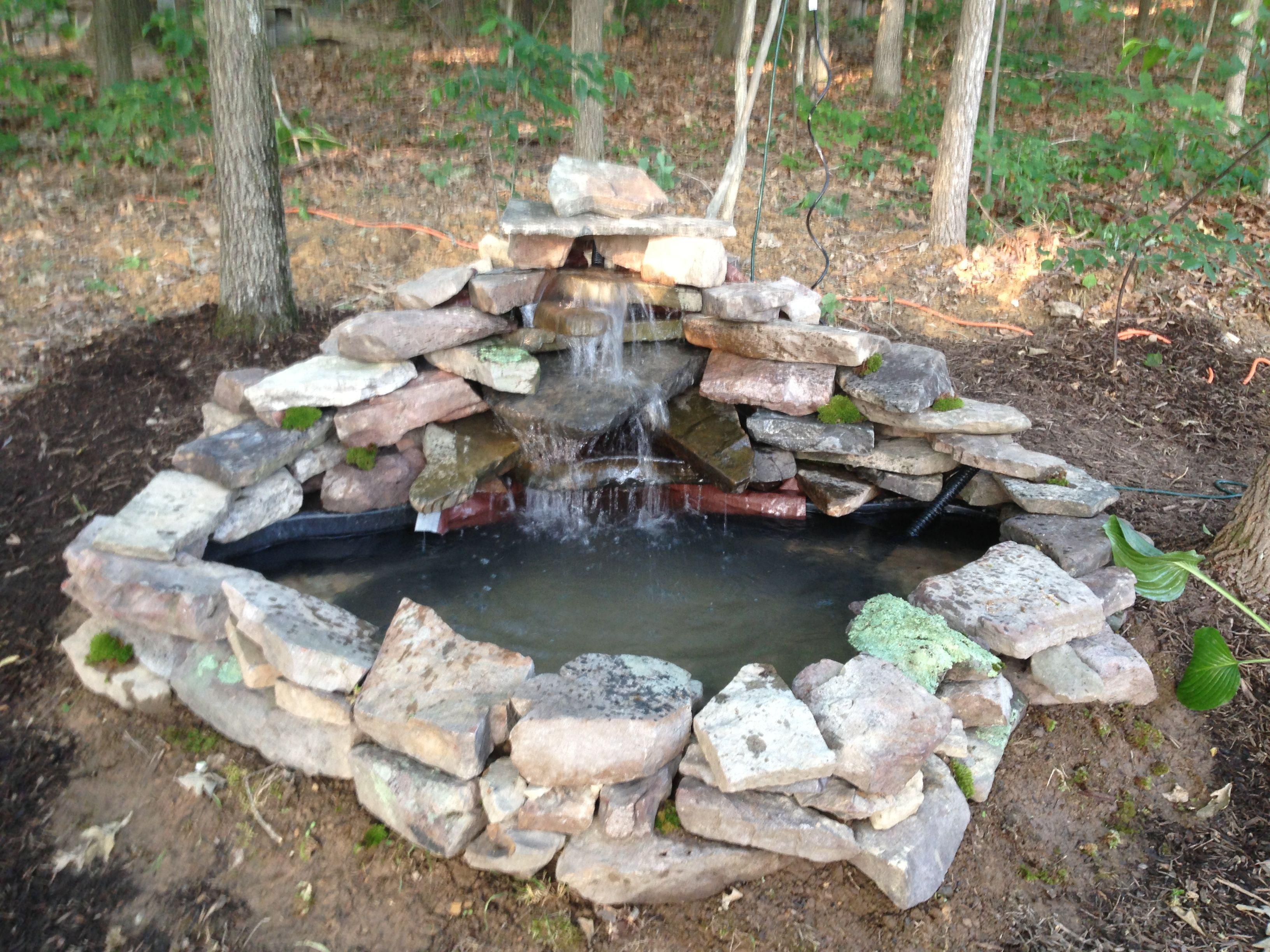 a 125 gallon pre form pond with 800 gallon per hour pump creating a