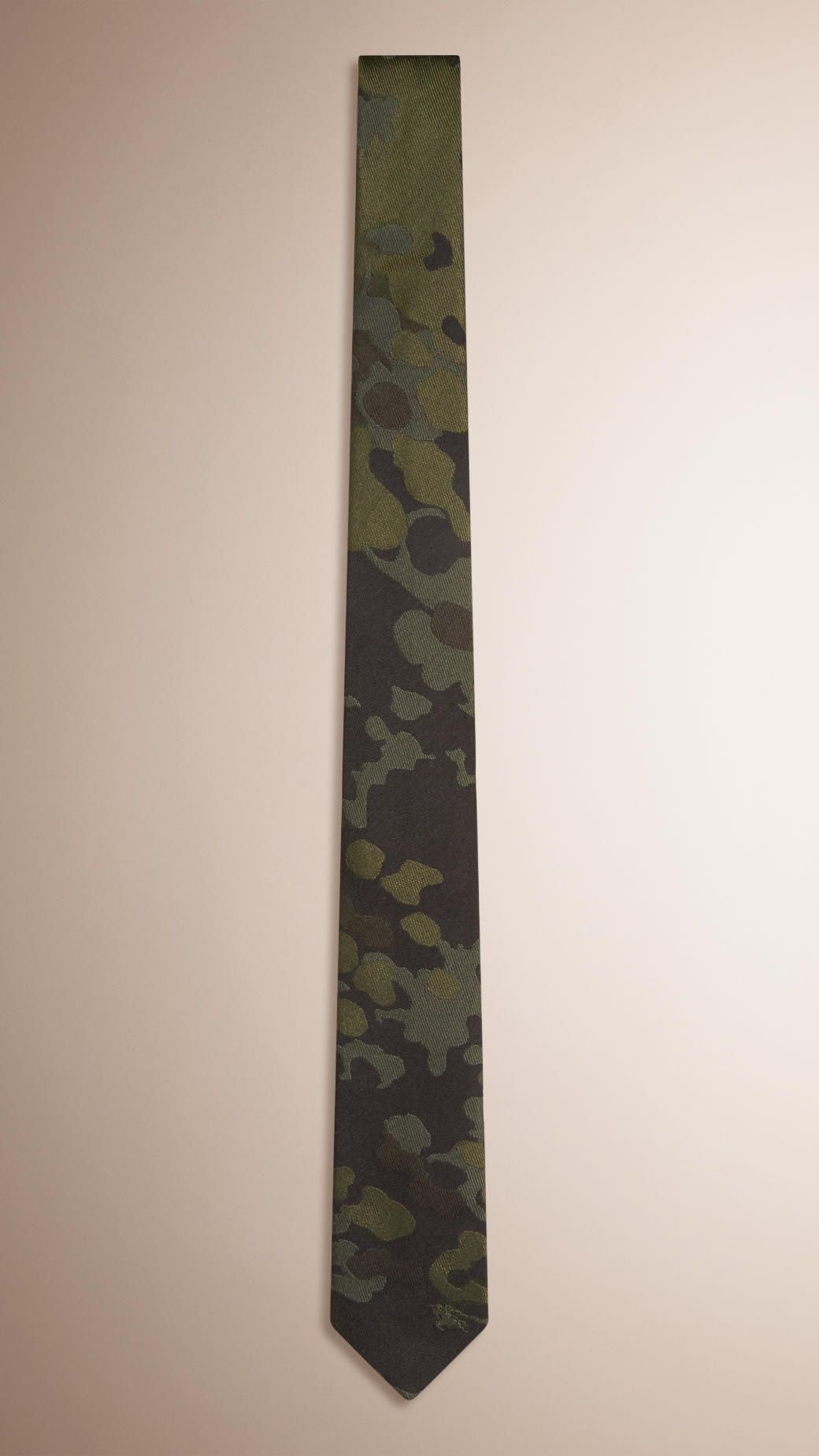 Handmade in England, a jacquard-woven silk tie featuring a camouflage design.