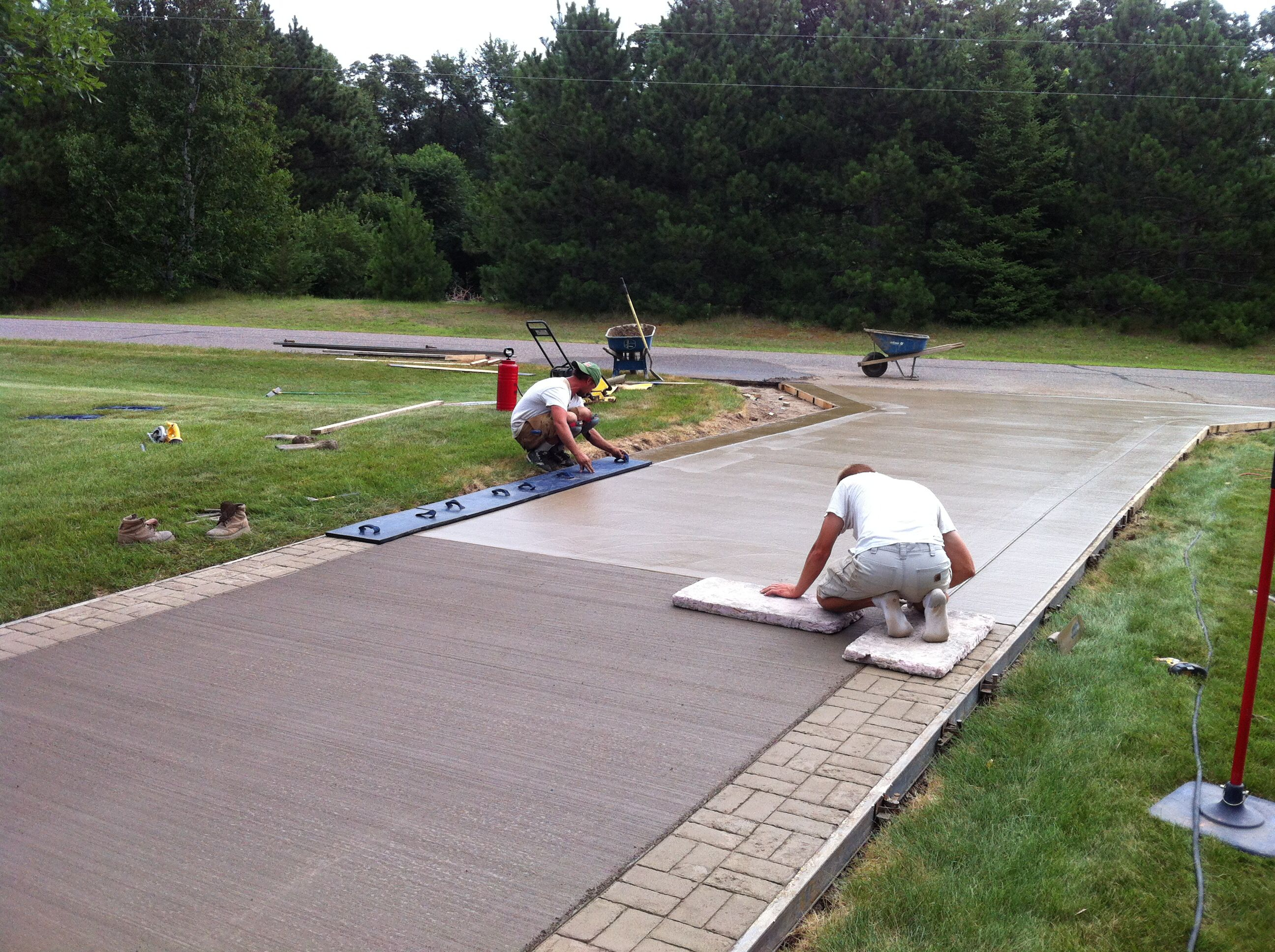 In Progress Photo Brush Finished Concrete Driveway With