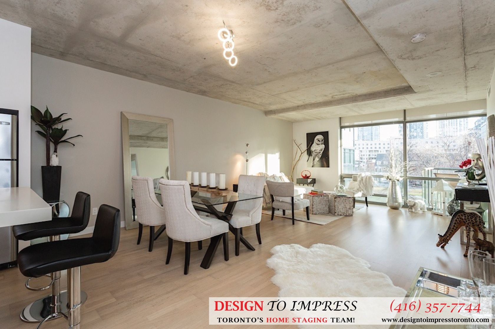 Living room in Downtown Toronto condo staged to sell for
