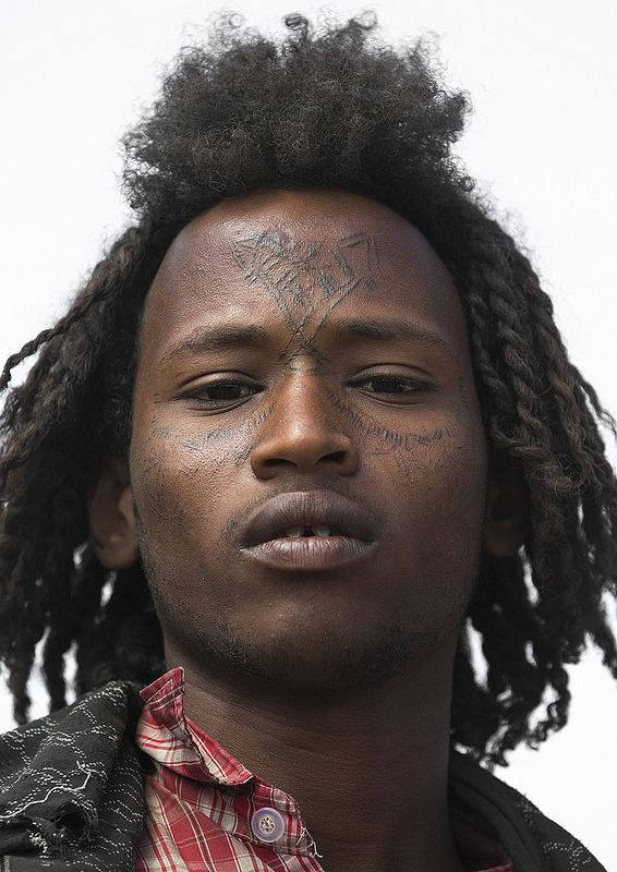 Afar Tribe Man With Curly Hair And Facial Tattoos Assayta
