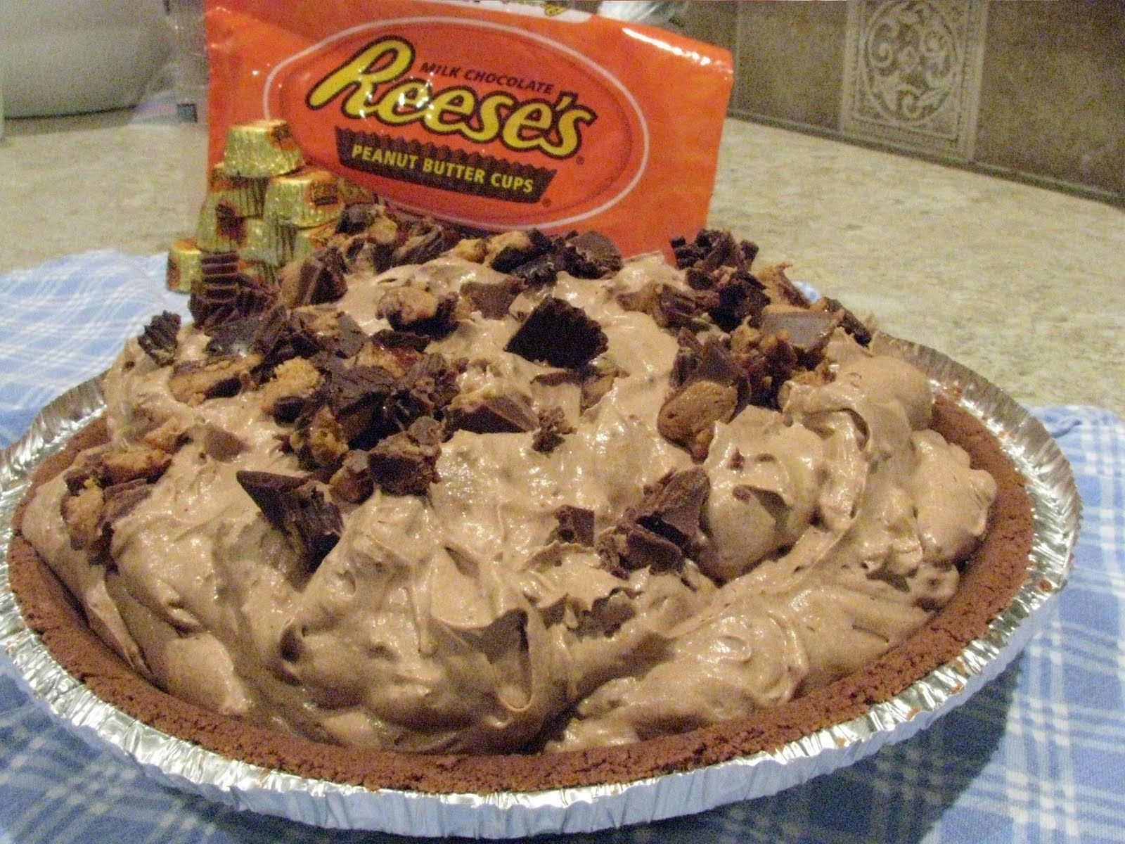Reese's Peanut Butter Cup Freezer Pie. Only 5 ingredients and 5 minutes prep time before its ready to be frozen.