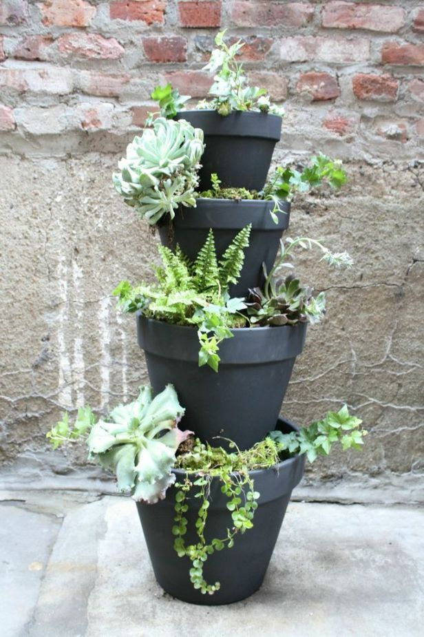 """Planterfall. This chic planter can be yours in just a few steps. You will need: Seven terra cotta pots (one 6-inch, three 8-inch, one 10-inch, one 12-inch and one 14-inch), a 12.25 inch terra cotta saucer, 1 medium bag of potting soil, 1 medium bag of pea gravel or stone, a 1/2"""" 4-foot dowel, one can of black spray paint, and a saw for cutting the dowel."""
