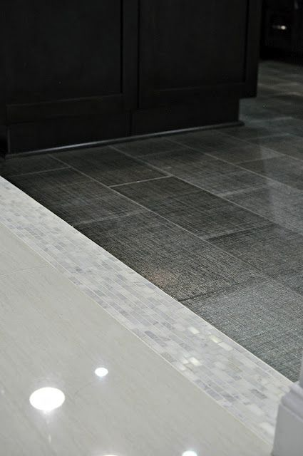 Floor Tile Transition Incorporates A Band Corresponding With
