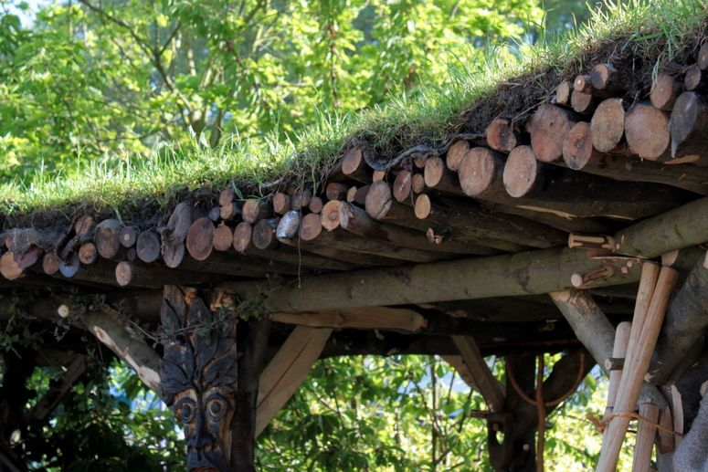 rustic pergola with green roof made with sawn branches | zahrady