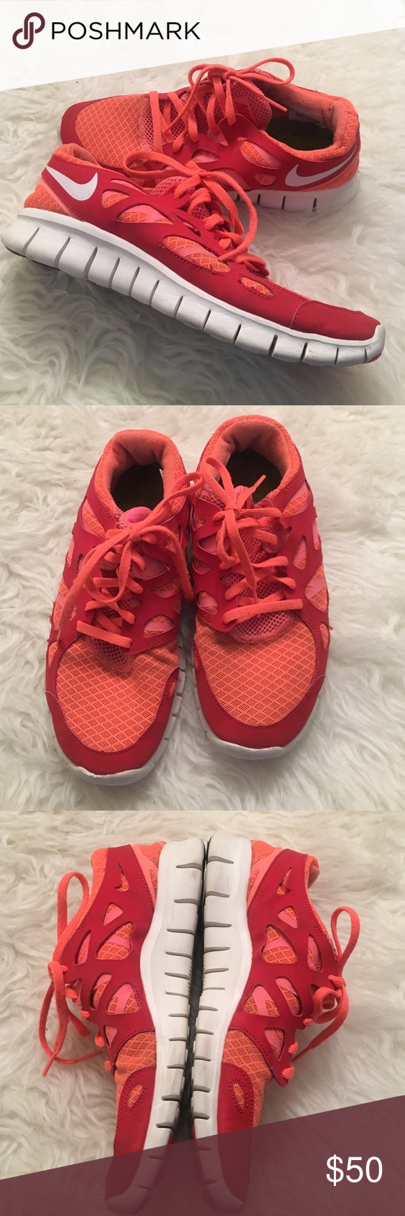 Barely worn Nike Free Run Orange, pink and red toned Nike sneakers. Barely worn in great condition. Size 9 and fit true to size. Comfortable and great for working out Nike Shoes Athletic Shoes