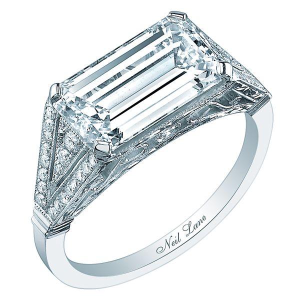 Emerald-cut diamond ring horizontally set in platinum by Neil Lane