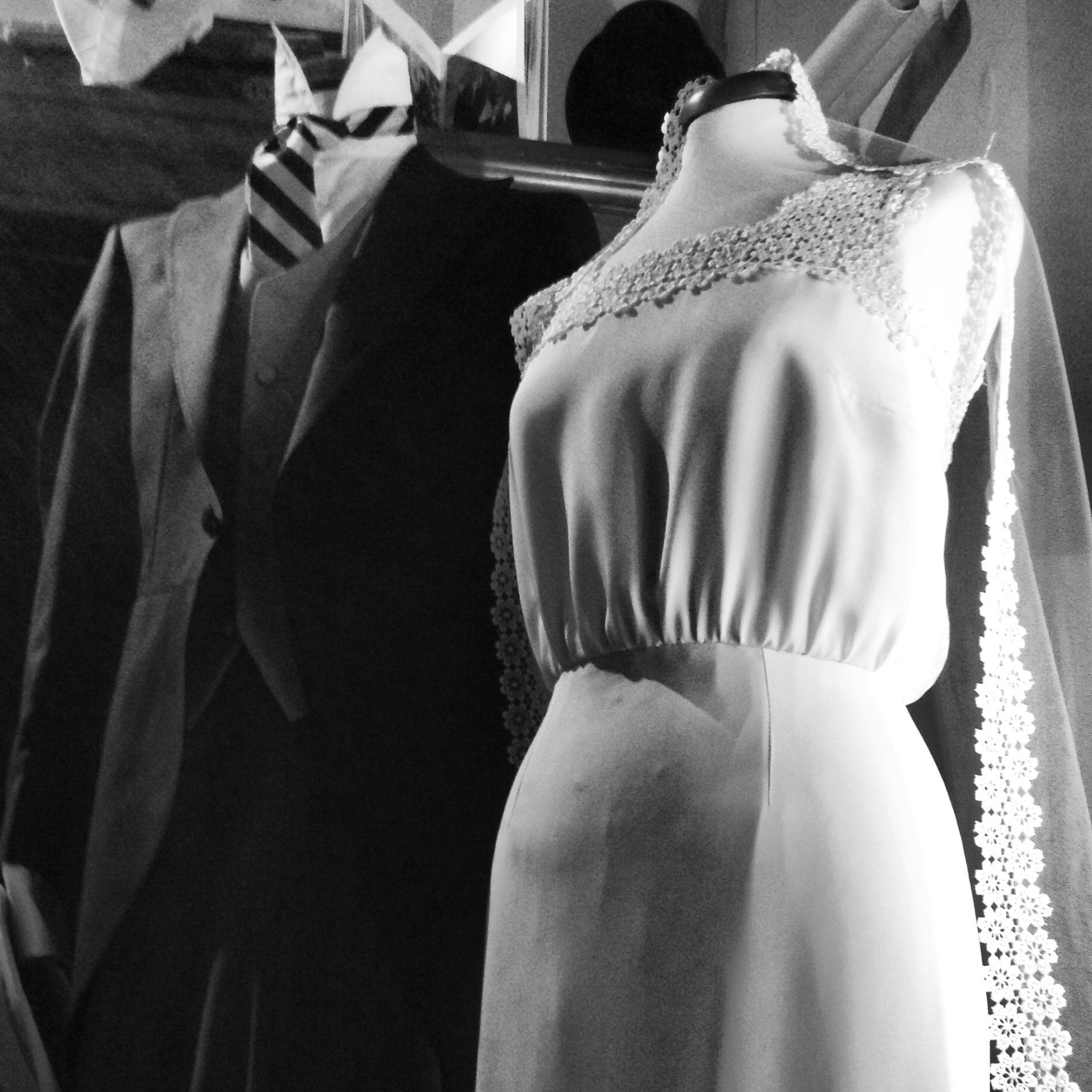 Tailored wedding gown made of silk and macramé lace