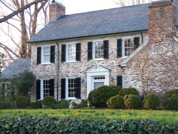 A White Washed Brick Exterior On A Traditional Style House That Gives It That Old World Feeling Exterior Brick House Exterior Colonial Style Homes