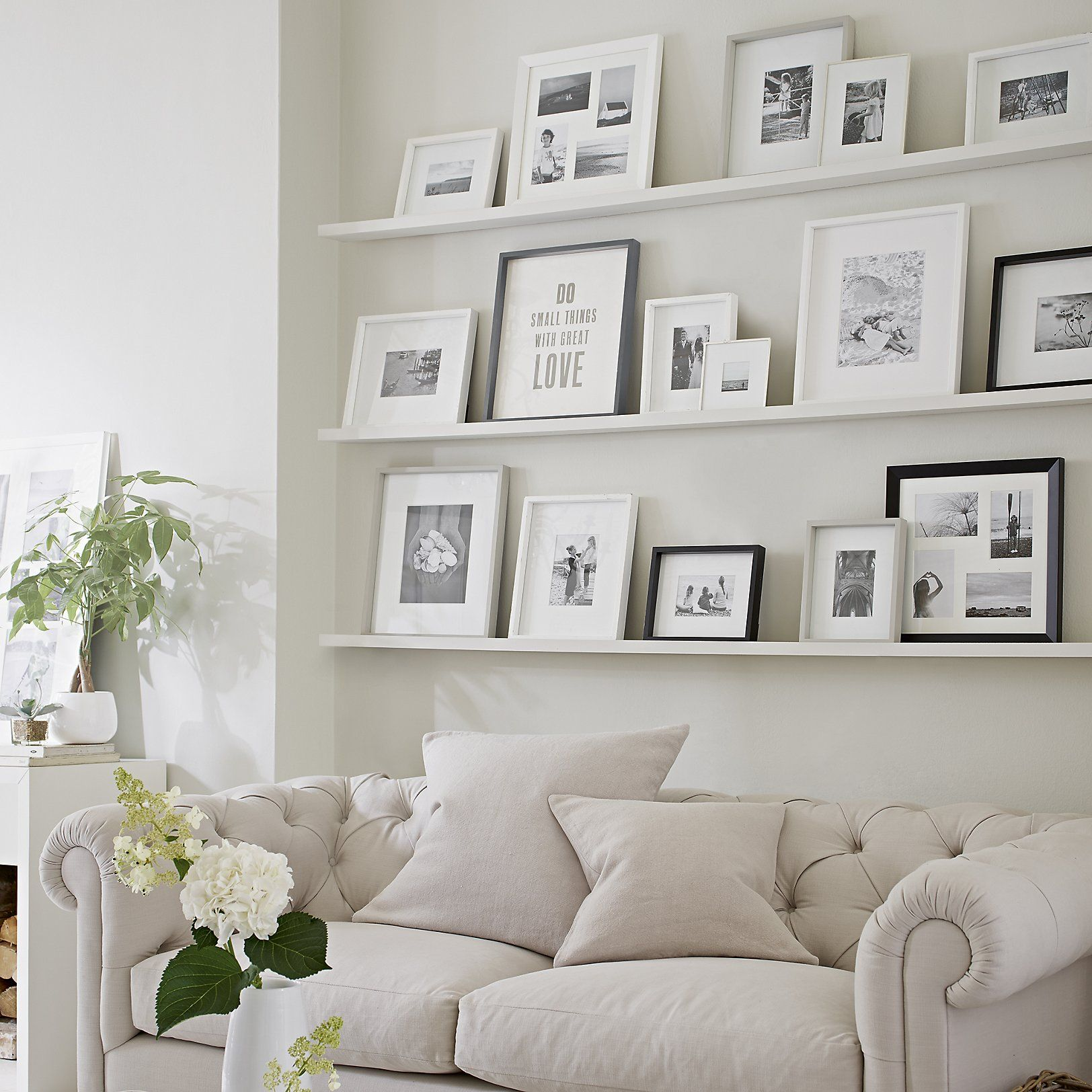 All white picture frame arrangement decor home decor interiors living room