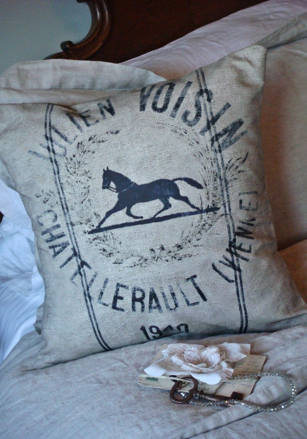 The Equestrian cotton and burlap pillow. via Etsy.