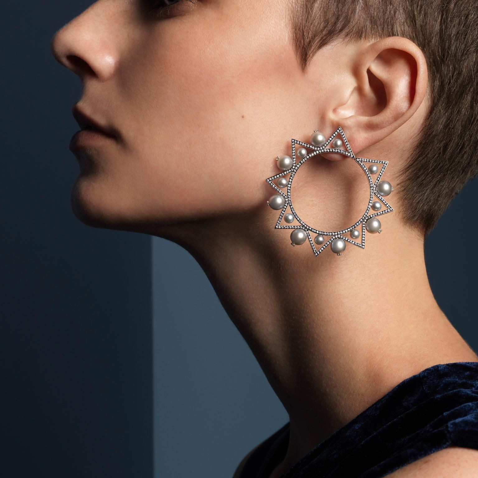 Nikos Koulis Lingerie pearl hoop earrings set in white old with diamonds. Geotmetric style. Modern design for pearls. Photo with pixie crop hairstyle. http://www.thejewelleryeditor.com/jewellery/top-5/top-5-pearl-jewels-with-attitude/ #jewelry
