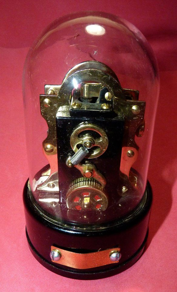 Dow jones Wall Street ticker tape machine miniature vintage Lighter. Yes that is right, you can light a cigarette (or whatever) with it!