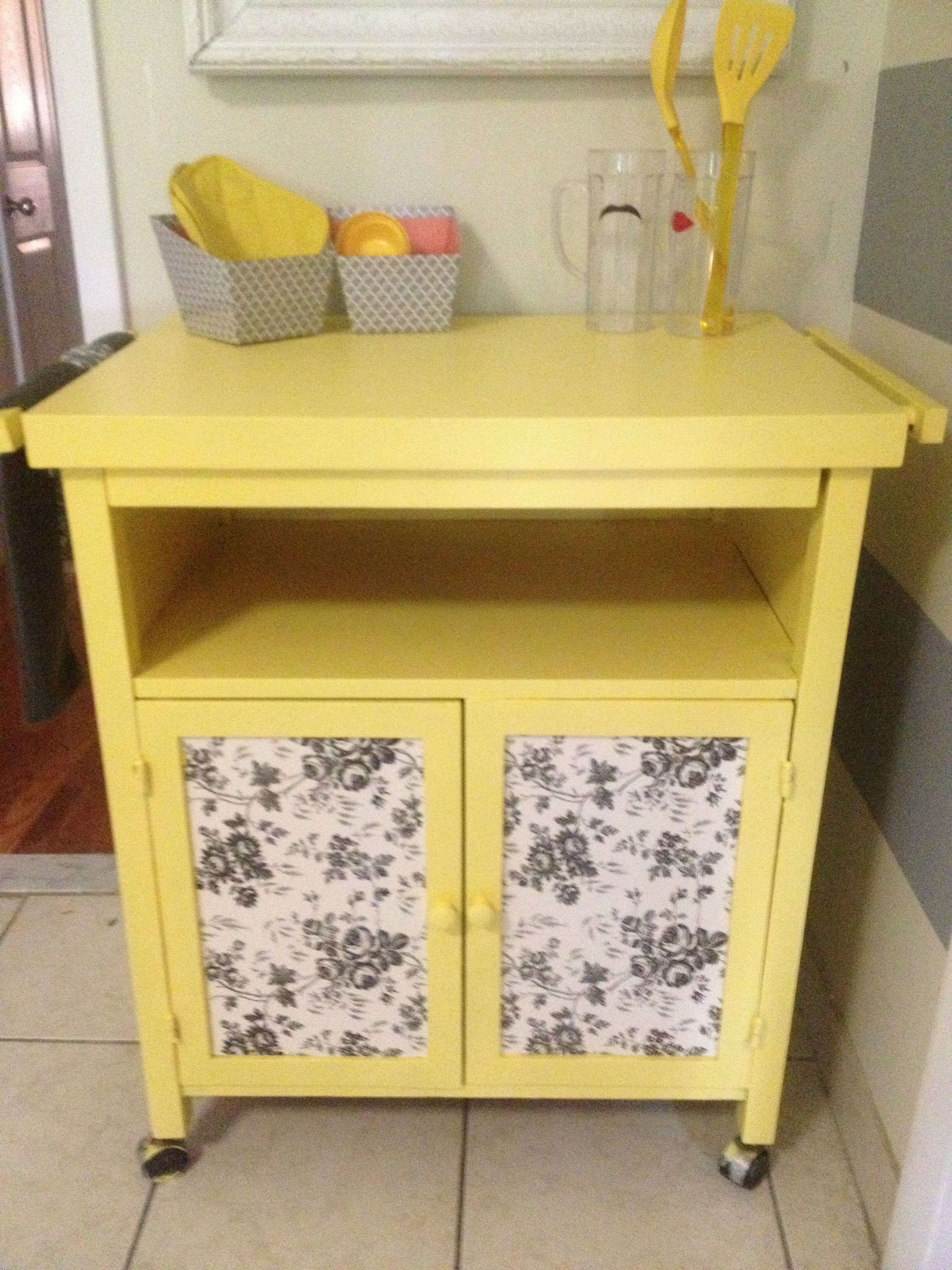 Took an old red kitchen cart, some paint, & dollar store ...