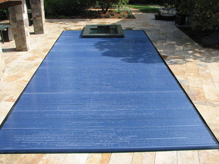 A beautiful slot overflow pool with hydralux cover in the for Overflow pool design
