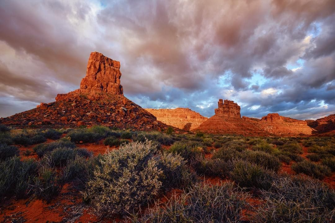 Photo @ladzinski / The #ValleyOfTheGods is an off the beaten path BLM recreation area in Southern Utah. Numerous sandstone towers dominate the landscape throwing long shadows at sunrise over the sage fields. It's beauty matches it's name and it's no wonder that it's been the backdrop to numerous western films and movies. @natgeocreative @3stringsproductions by natgeo