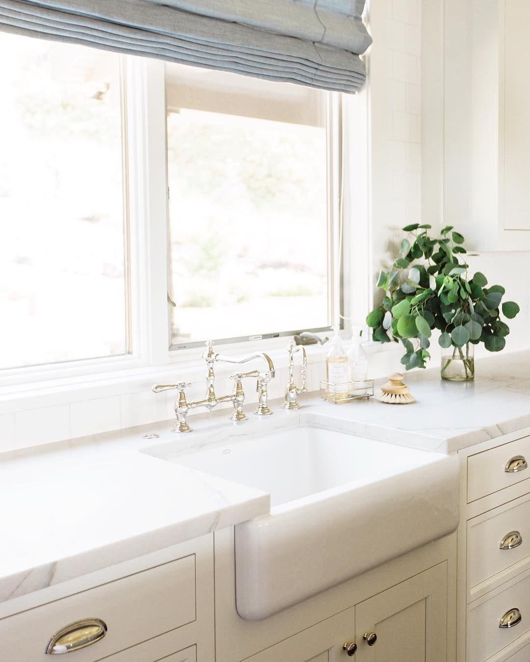Bright white kitchen + marble countertops www.studio