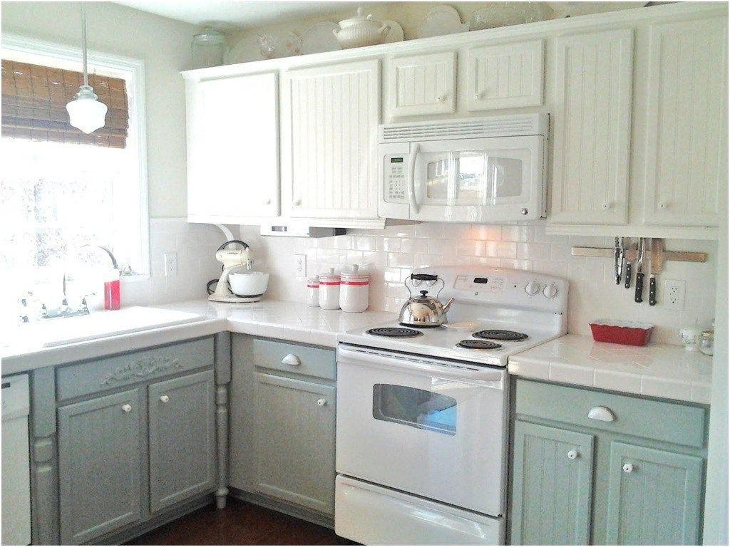 Painting oak cabinets white and gray counter top dark and gray from