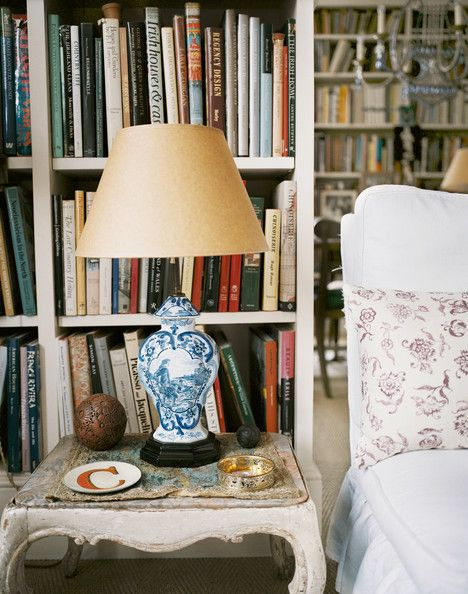 Carolina Irving - A craft-paper lampshade with a blue-and-white lamp on a wooden side table