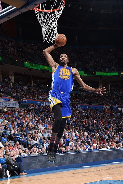 kevin durant of the golden state warriors dunks against