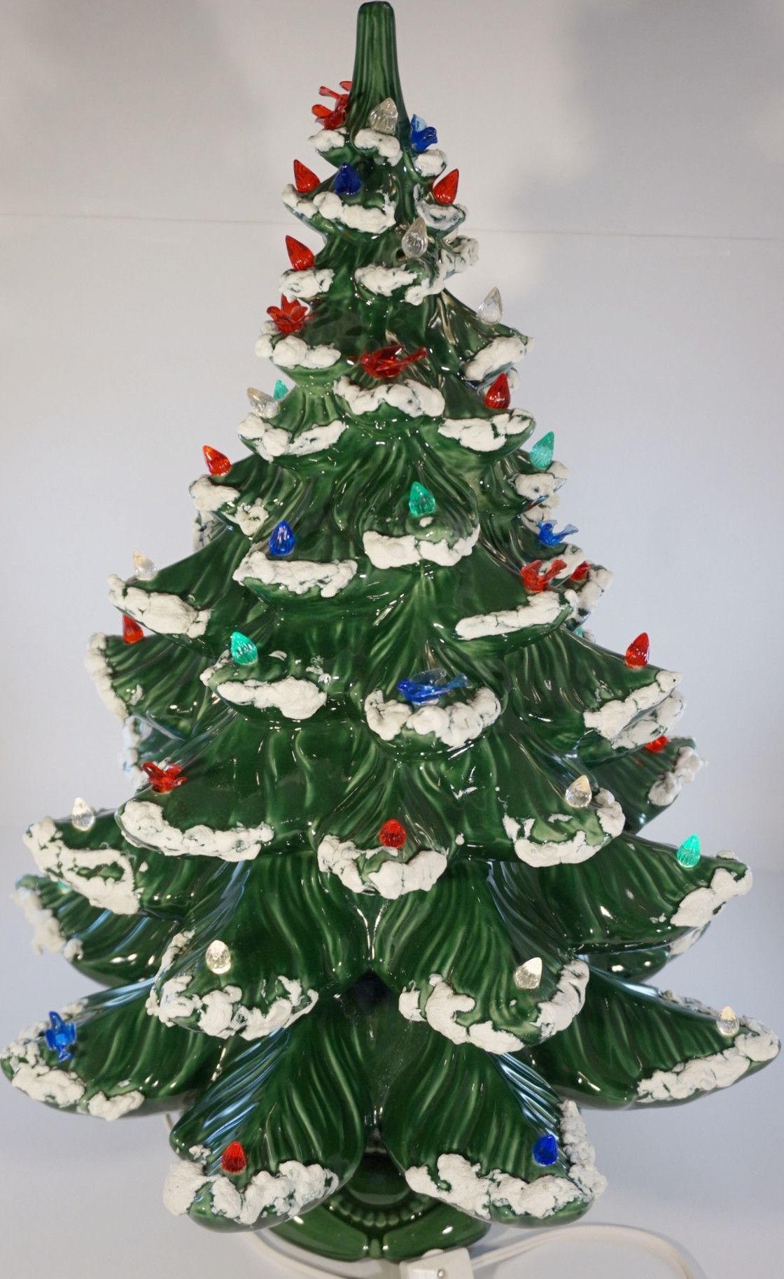 large ceramic christmas tree we have one similar to this that is at least 40 years old some of the decorations have dissapeared my mother has a hard time
