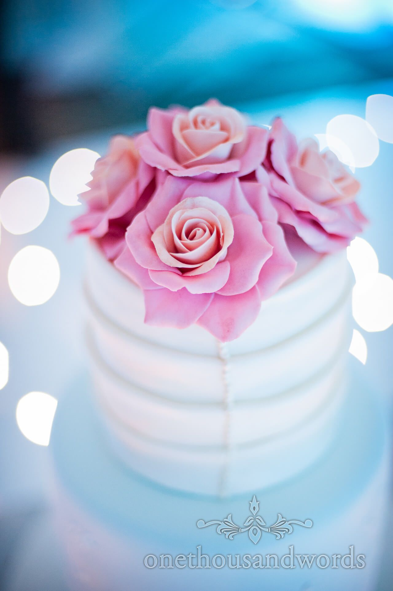 Pink Roses and white pleated wedding cake photograph by one thousand ...