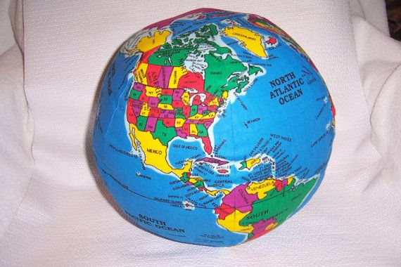 This soft globe is a learning toy / ball / pillow that ...