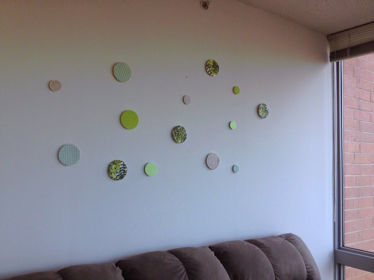 Scrapbook paper cut into circles and glued onto candle tops. Makes for a cute wall accent piece!