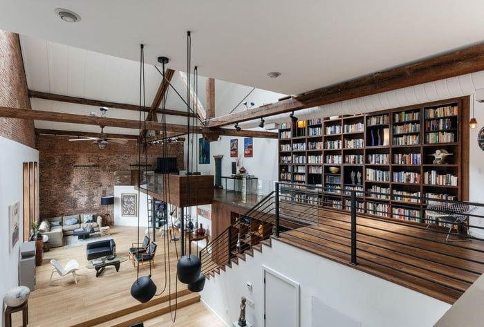 Loft features exposed joists and brick in this former 1890