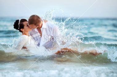 Lovely Couple Kissing In The Sea Miami Beach Wedding Wedding Venues Beach Honeymoon Pictures