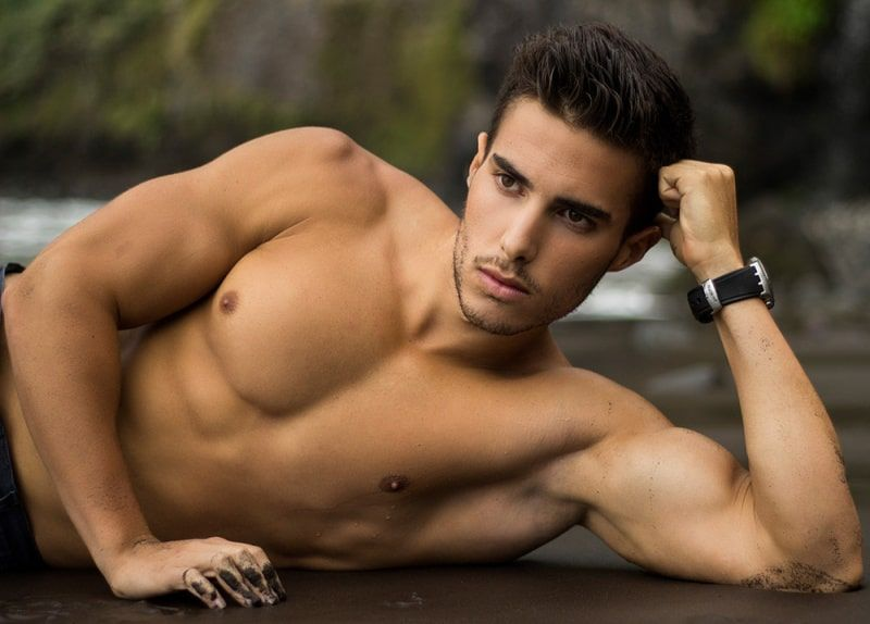 Nice male body gets a massage