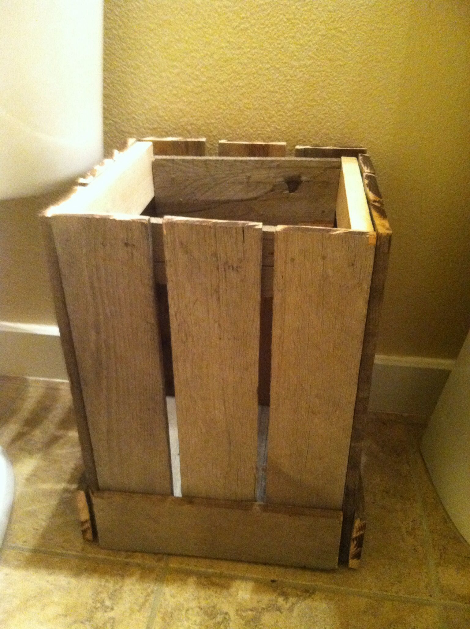 Trash can made out of a pallet and a couple pieces of scrap wood.