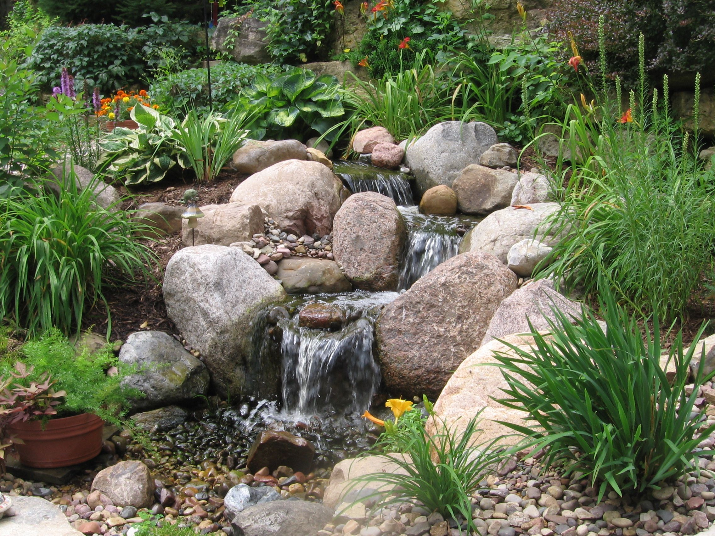 A pondless water feature by the bruce company ponds for Garden pond water features