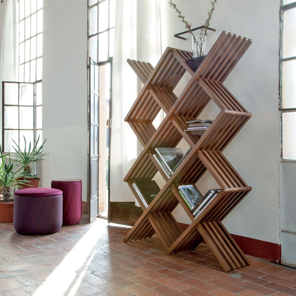 Enjoy the pure simple beauty of the Arpa Bookcase from Tonin Casa. This solid wood bookcase allows books to lay at a slat, without need for bookends.