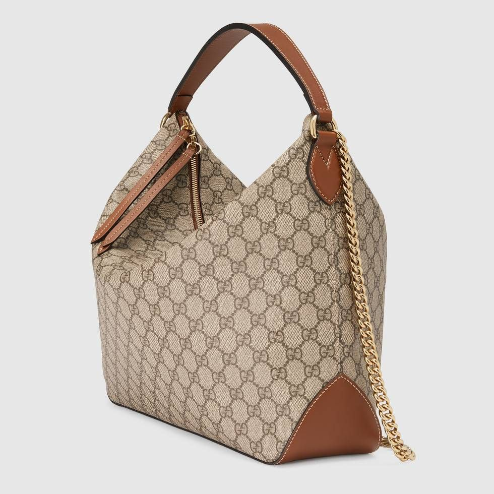 61db0a443ac8 Shop the GG Supreme large hobo by Gucci. A large hobo with an attached  chain shoulder strap and a leather top handle. The handles have been  hand-stitched ...