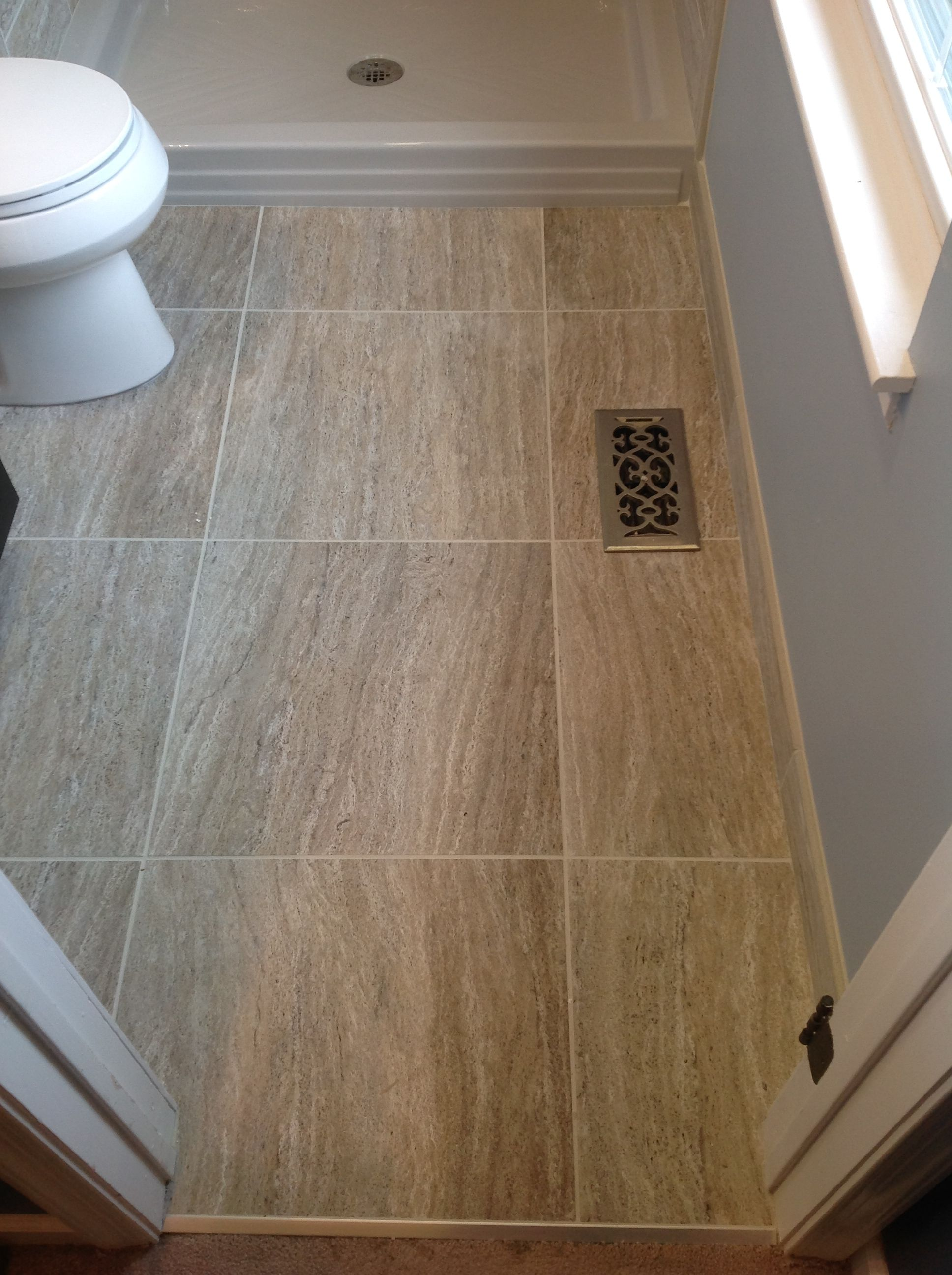Tile work in bathrooms - Marazzi Silk Elegant Floor Tiles In A X Floor Space Large Format Tiles Work Nicely In A Small Bathroom