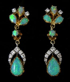 A Pair Of Vintage Opal And Diamond Earrings