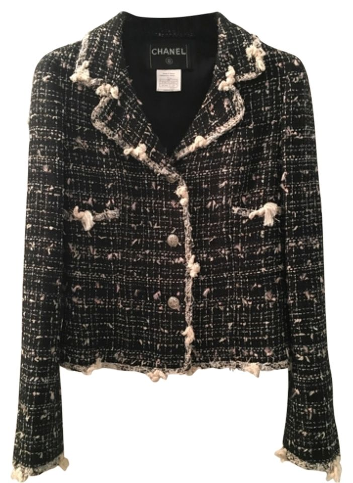 1f1b7f49ce1 Chanel classic black and white tweed jacket. This jacket features black and  white fantasy tweed with fringed details. Unique silver buttons have 5 cute  ...