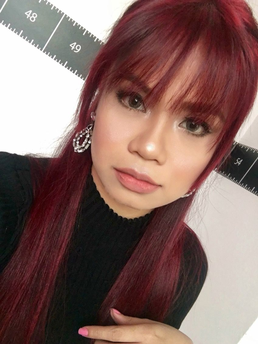 Wine red straight hair with fringe in light makeup for asians