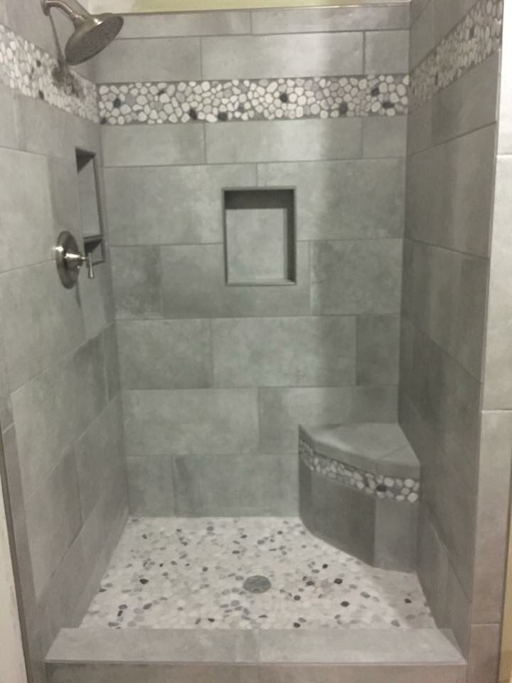 Shower Remodel With Gray Tile And Stones Built In Shelves And