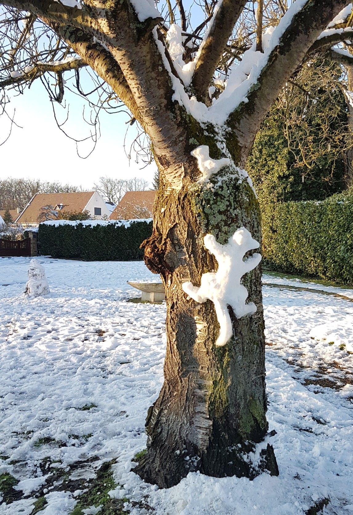 Sculpture sur neige Le chat et l'oiseau Aude C.