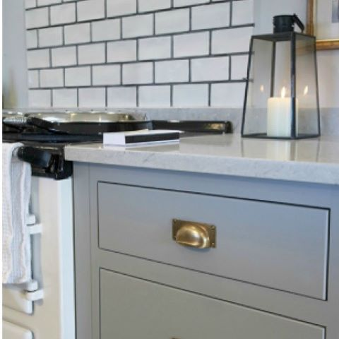 Beautiful white AGA, perfect grey cabinetry and old brass hardware - all a perfect partnership.