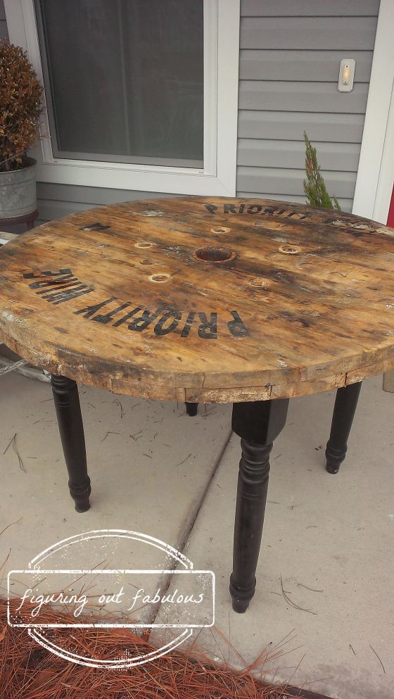 patio table made from cable spool and an old student desk