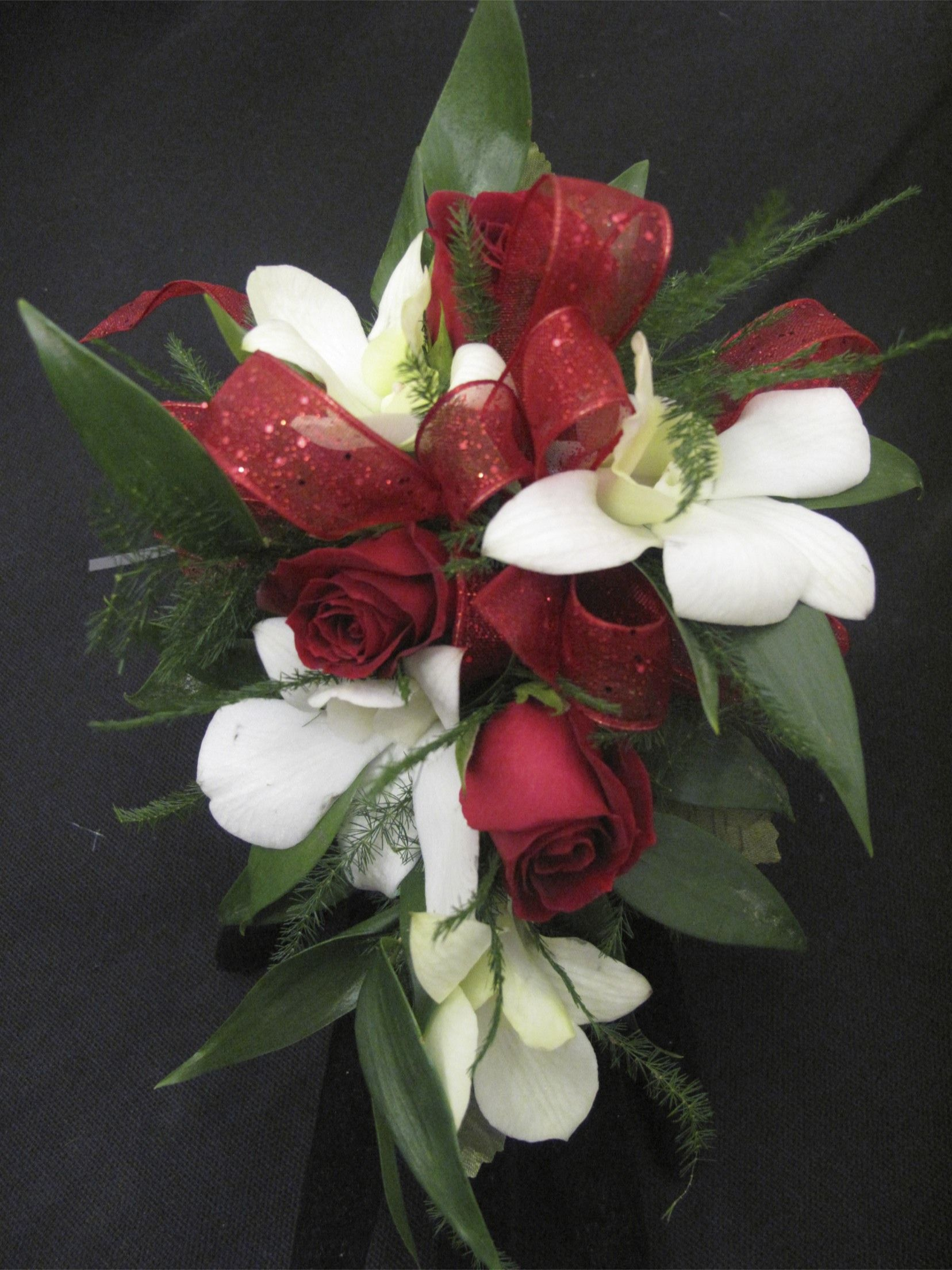 Red Spray Roses and white dendrobium orchid corsage for Prom ...