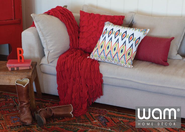 Red home dcor coordinating red throw rug with red cushions
