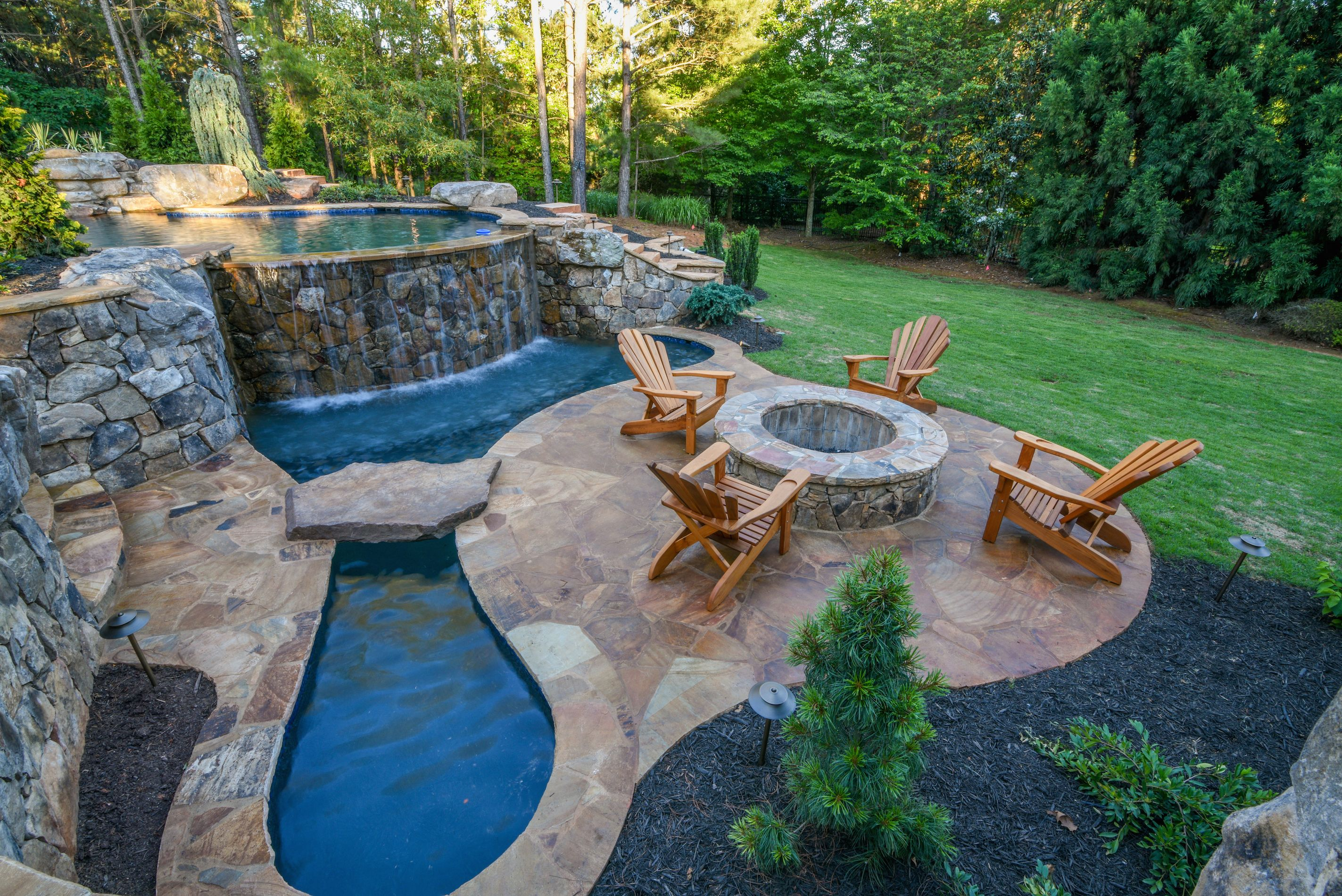 Custom built swimming pool and outdoor living space designed and built by Georgia Classic Pool.