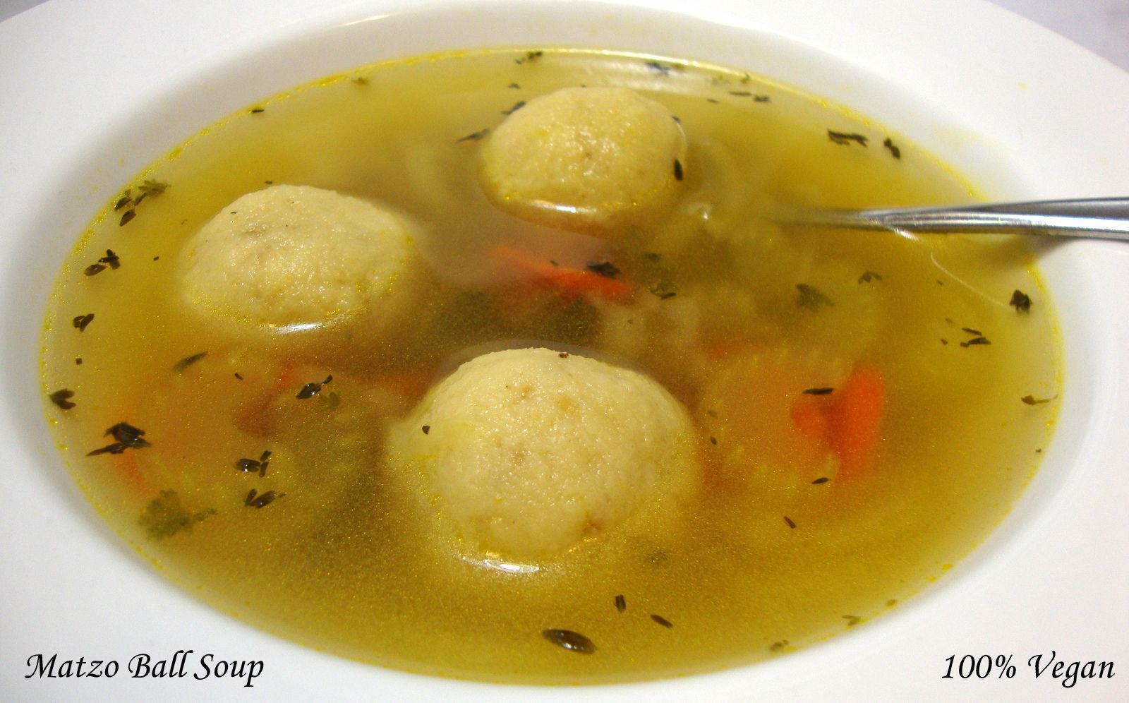 """Best Matzo Ball Soup: The matzo balls are served in a """"no-chicken"""" broth flavored with thyme, parsley and a mirepoix of carrots, celery and onions; simple and yet delicious. This recipe yields 6 medium-size matzo balls and about 1 quart of soup."""
